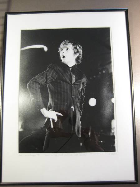someone selling a framed photo of beck from this show